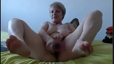 Blonde granny masturbates with dildo..