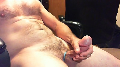 Hairy Daddy plays with fat cock and..