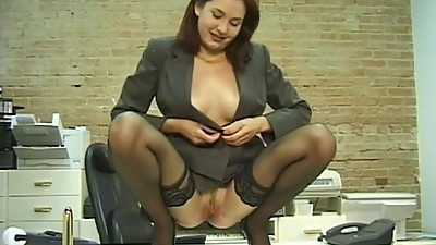 Horny office chick in stockings..
