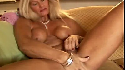 Sexy cougar slips out of her panties..
