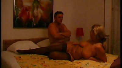 A chubby old milf sits on a stiff cock..
