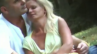 Milf sitting with no panties in a park