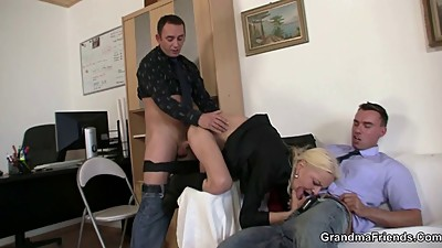She sucks and fucks two cocks at job..