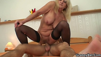 Old bitch jumps on his horny cock