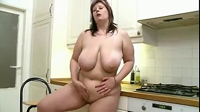 Plump babe with big boobs masturbates..