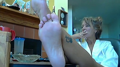 Mature woman shows feet