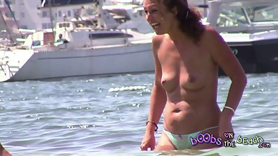 MILF Hippy getting wet on beach with..
