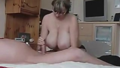 Hot MILF with HUGE tits strokes an old..