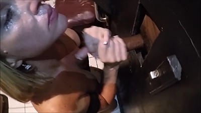 Wife enjoys BBC through glory hole..