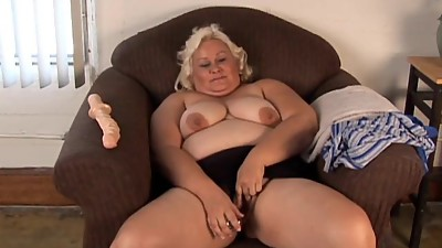 Cute chubby blonde MILF has a soaking..
