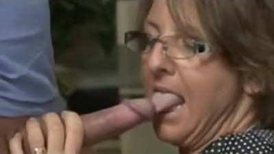 Milf Buffs Her Mans Rod With Her Mouth..