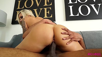 Busty Nina Elle taking a huge black cock