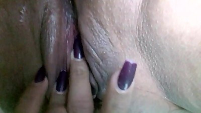 Hot milf wet pussy fingering close up..