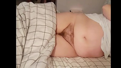 her hairy pussy laying on her side