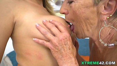 Busty granny and her younger lesbian..