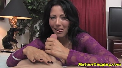 Busty office milf tugging cock with..
