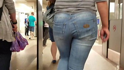 Nice woman's ass in blue jeans