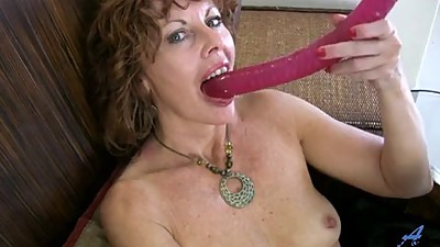 Milf rubs her pussy to orgasm